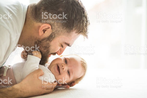 Father with newborn baby