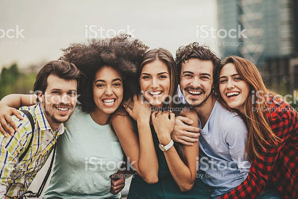 Group of happy and young people