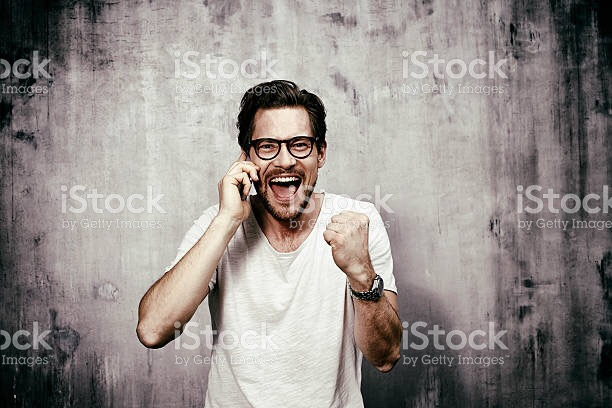 Young man gains good news over phone ecstatic
