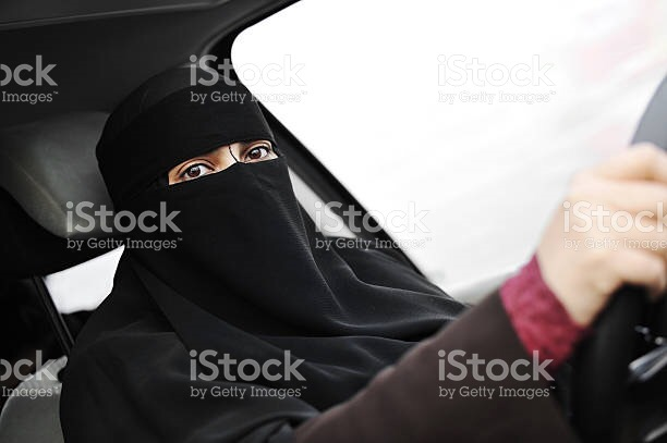 Saudi woman driving with niqab on